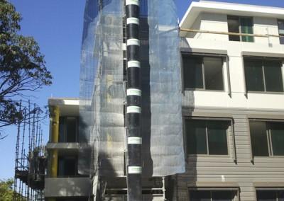 Aussie_builders_chute_new_residential_development_0913